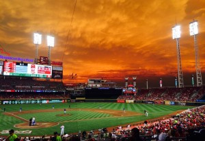 The field at Great American Ballpark with an orange sky.